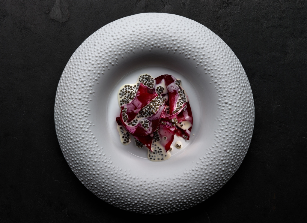 Salt crusted beetroot with garden caviar cream from Mirazur.