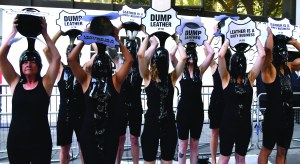 A Peta protest against the use of leather, on the first day of London Fashion WeekPETA protest, London Fashion Week, UK - 13 Sep 2019 London Fashion Week attendees will get an eyeful on Thursday when a group of PETA supporters will pour buckets of black 'toxic slime' over their heads to call attention to the hazardous waste associated with the leather industry. Signs on the buckets will read, 'Leather Is a Dirty Business' and 'Dump Leather'.