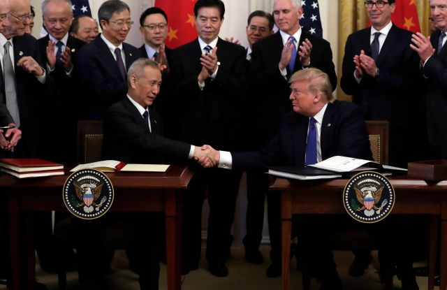 Donald Trump Liu He. President Donald Trump shakes hands with Chinese Vice Premier Liu He, after signing a trade agreement in the East Room of the White House, in WashingtonTrump US China Trade, Washington, USA - 15 Jan 2020