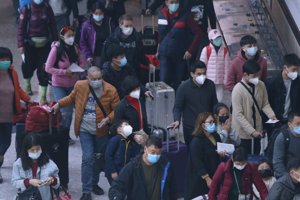 Passengers arrive at Hong Kong West Kowloon High-Speed Railway Station from China amid an outbreak of Wuhan coronavirusCoronavirus Outbreak, West Kowloon, China - 28 Jan 2020 Hong Kong reported its eighth imported case of infection on Sunday. Pressure calling for closing the Hong Kong border to all visitors from mainland China to contain the deadly coronavirus sweeping the country is mounting, even as the government banned everyone who had visited Hubei province within the past two weeks from entering the city