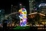 Pictured against the skyline of the financial district, a floral pattern is projected on facade of the Merlion statue as part of a projection display titled 'Elements of Life' during the i Light Marina Bay Festival in Singapore, 09 March 2018. The i Light Festival will run from 09 March till 01 April and features art work made from recyclable or sustainable materials.i Light Marina Bay Festival in Singapore - 09 Mar 2018