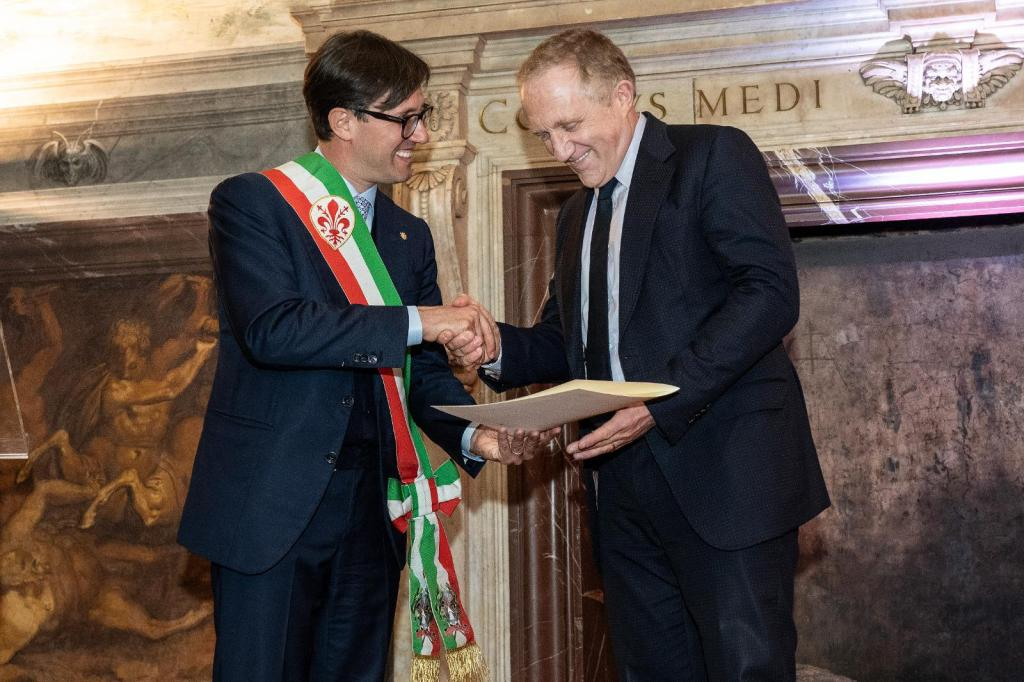 Kering's chairman and ceo François-Henri Pinault receives the Fiorino d'Oro award by Florence's mayor Dario Nardella.