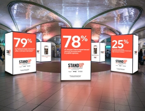 A rendering of Stand Up posters in a train station.