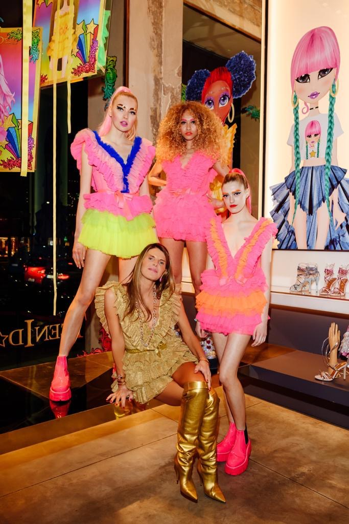 Anna Dello Russo with models at the Antonia x Teen Idol party.