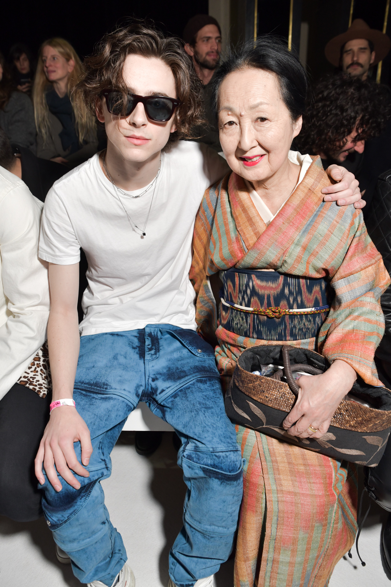 Timothee Chalamet and Setsuko De Rola Klossowska in the front row