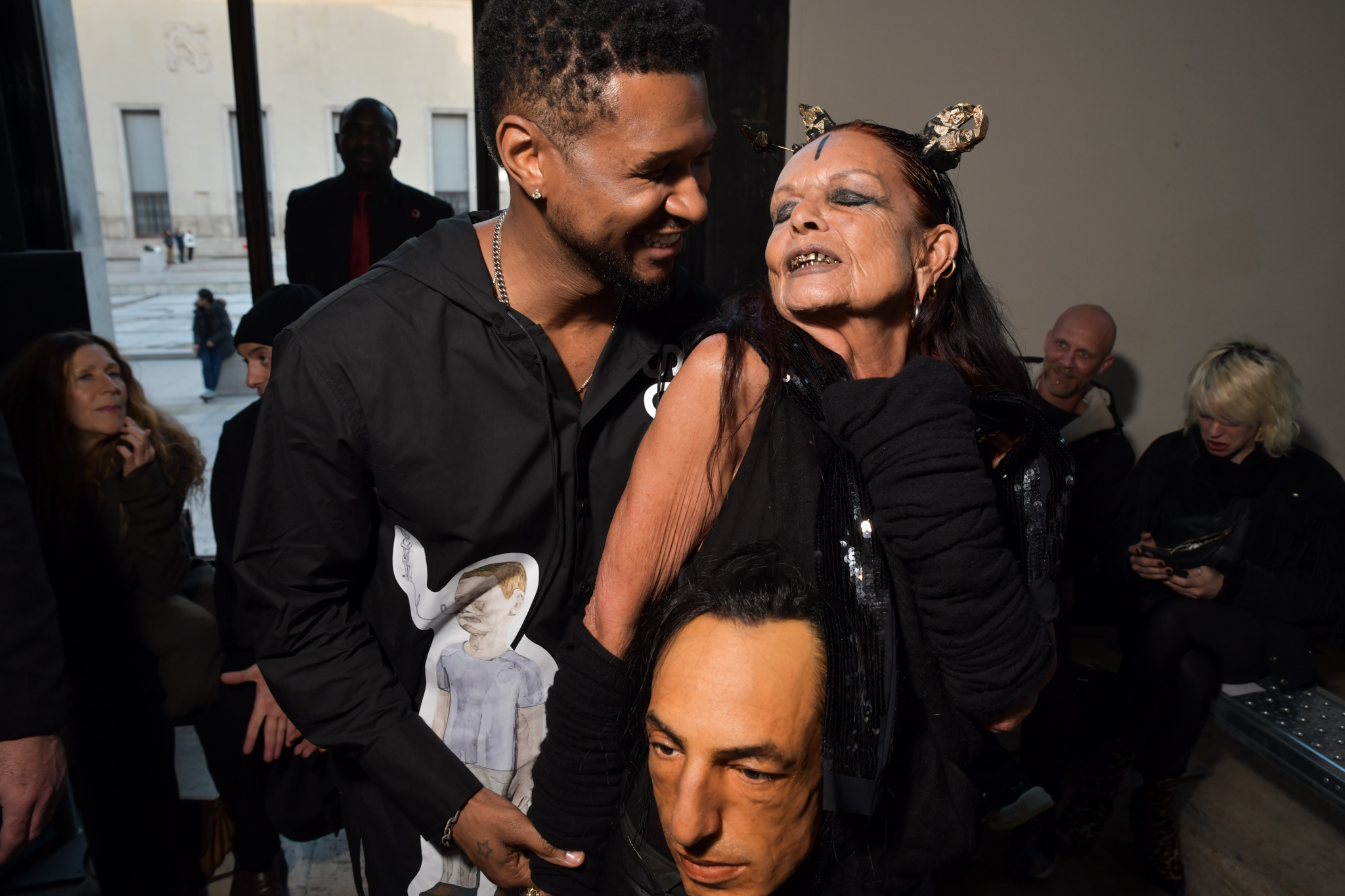 Usher and Michele Lamy in the front row