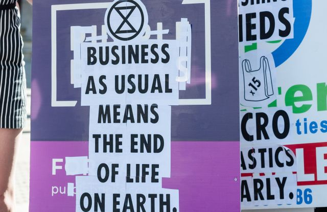 Extinction Rebellion activists stop traffic outside the Foreign Office ahead of Victoria Beckham's show at the London Fashion Week. Protesters call for the British Fashion Council to cancel London Fashion Week until it can be sustainable in the face of climate crisis and ecological emergency.Extinction Rebellion protest, London Fashion Week, London, UK - 15 Sep 2019