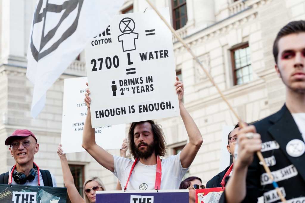 Extinction Rebellion activists demonstrate outside the Foreign Office ahead of Victoria Beckham's show at the London Fashion Week. Protesters call for the British Fashion Council to cancel London Fashion Week until it can be sustainable in the face of climate crisis and ecological emergency.Extinction Rebellion protest, London Fashion Week, London, UK - 15 Sep 2019