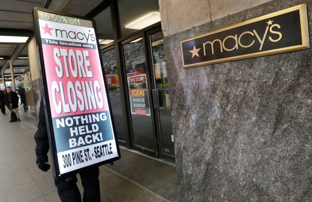 "Raymond Martin walks with a ""store closing"" sign on his back in front of the Macy's store in downtown Seattle. The store is one of nearly 30 Macy's stores to be closed nationwide in the coming weeks Macys Closing, Seattle, USA - 09 Jan 2020"