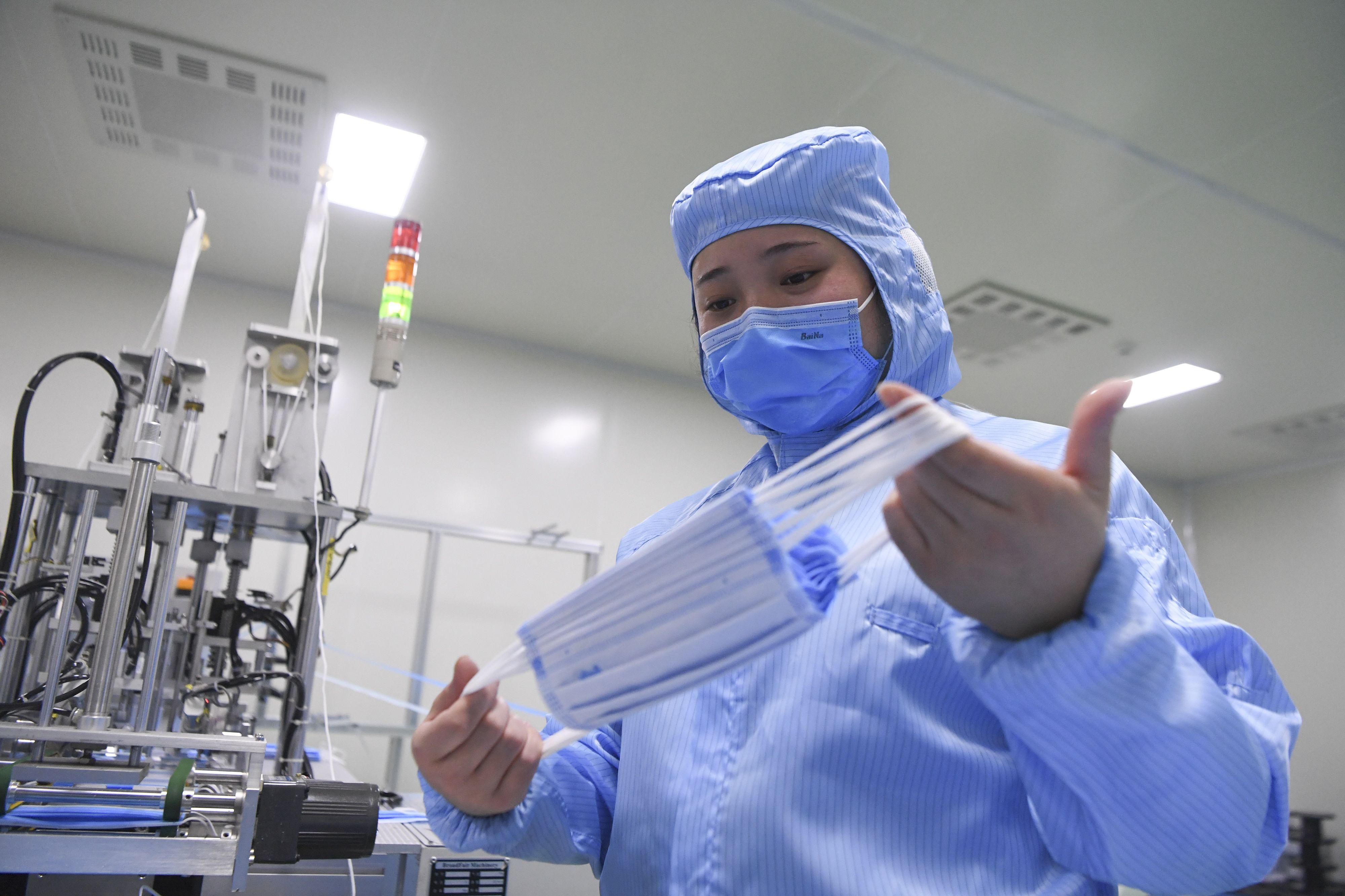 Production of face masks in Chongqing, China - 27 Jan 2020