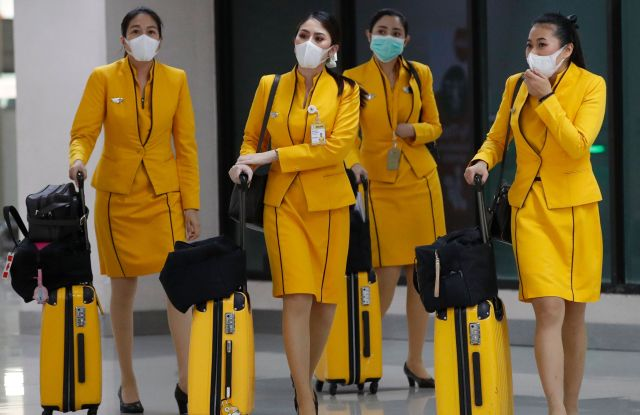 Flight attendees wearing surgical masks arrive at Don Mueang Airport in Bangkok, Thailand, 07 February 2020. Thai Public Health officials said that the number of people infected with the novel coronavirus in Thailand remained at 25. Nine had been discharged from hospitals. The virus has killed so far at least 638 people and over 31,000 others were confirmed infected, mostly in China.Thailand's surveillance measures against coronavirus outbreak, Bangkok - 07 Feb 2020