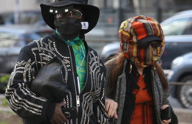 Guests wear face masks to protect against coronavirus upon arrival to attend the Dolce and Gabbana show during the Milan Fashion Week, Milan, Italy, 23 February 2020. The disease caused by the novel coronavirus (SARS-CoV-2) has been officially named COVID-19 by the World Health Organization (WHO). The outbreak, which originated in the Chinese city of Wuhan, has so far killed more than 2,000 people, with over 75,000 infected worldwide, mostly in China. The Fall-Winter 2020/2021 Women's collections are presented at the Milano Moda Donna from 18 to 24 February 2020.Dolce&Gabbana - Runway - Milan Fashion Week Women's FW 20/21, Italy - 23 Feb 2020