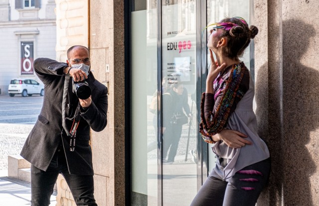 A photographer with a mask to protect himself from the COVID-19 coronavirus and a model take part in a fashion shootCoronavirus outbreak, Milan, Italy - 24 Feb 2020