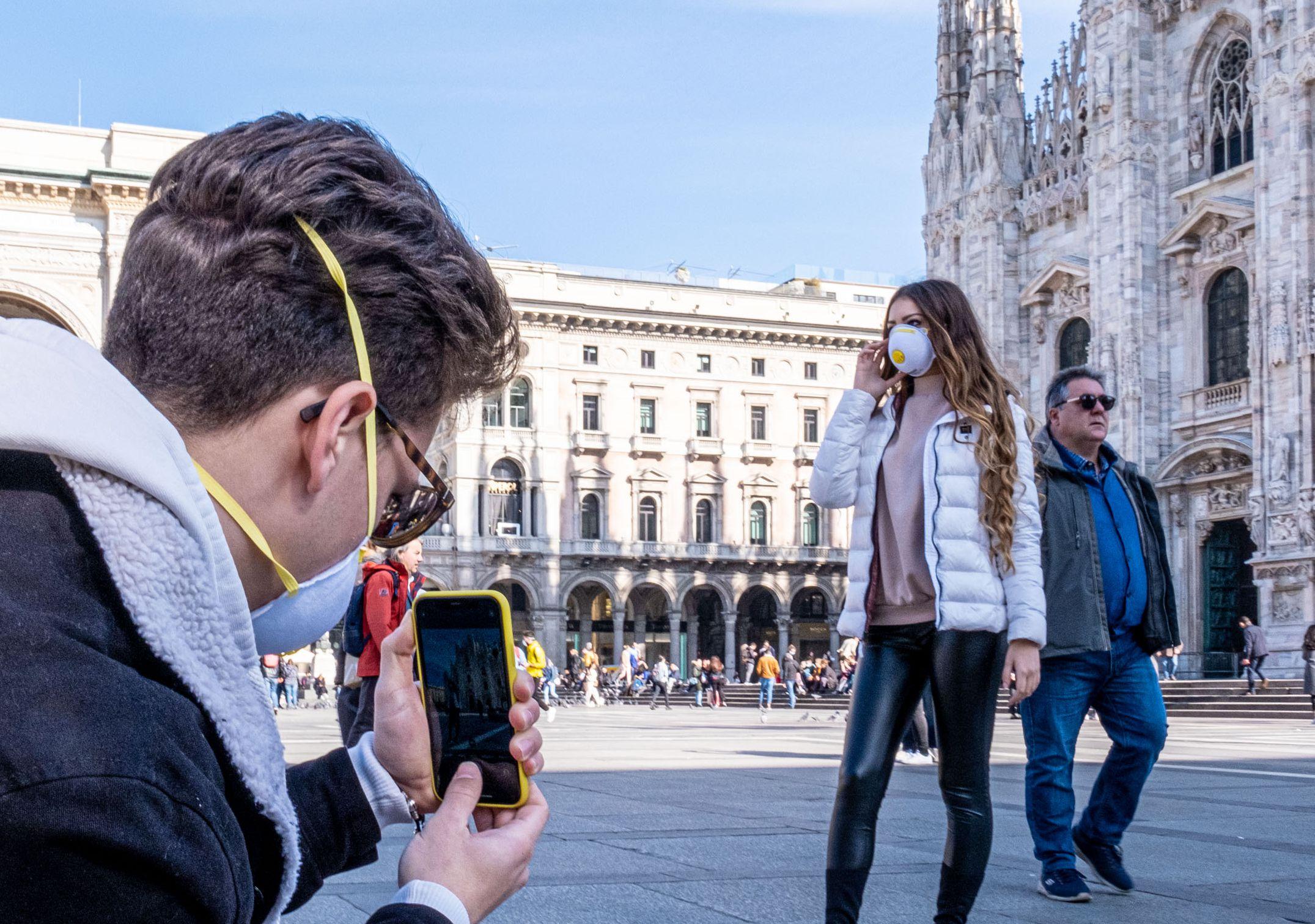 People wearing masks in Piazza DuomoCoronavirus outbreak, Milan, Italy - 24 Feb 2020