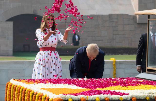 Donald Trump, Melania Trump. U.S. President Donald Trump and first lady Melania Trump offer floral respects at Raj Ghat, the memorial for Mahatma Gandhi, in New Delhi, IndiaUS Trump, New Delhi, India - 25 Feb 2020