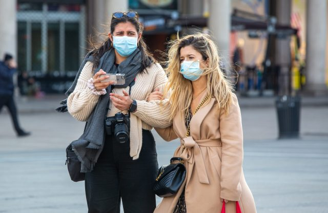 Pedestrians wearing face masks in Italy, which has witnessed a cluster outbreak of the coronavirus.