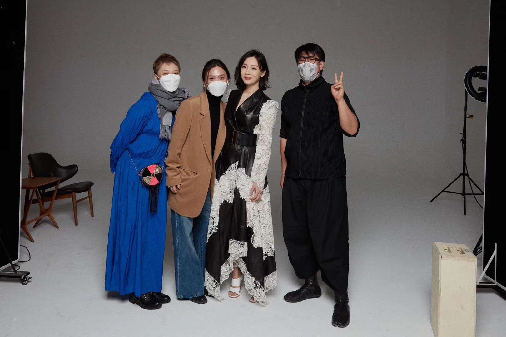 Jumbo Tsui on set with the team, wearing mask during the outbreak in China.