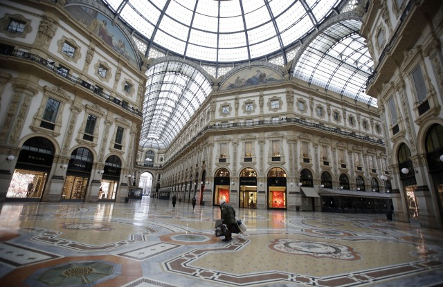 A nearly deserted Galleria Vittorio Emanuele II, Italy's oldest active shopping mall, in downtown Milan, Italy .
