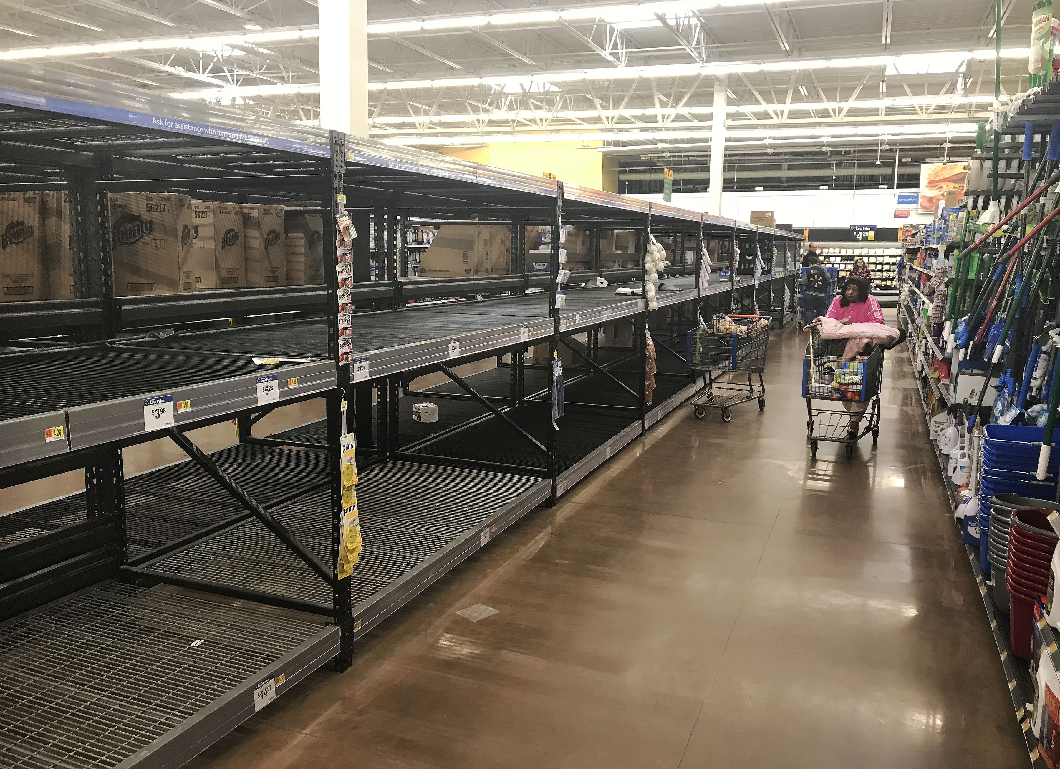 Shoppers emptied an aisle of toilet paper at a Wal-Mart in Streetsboro, Ohio.