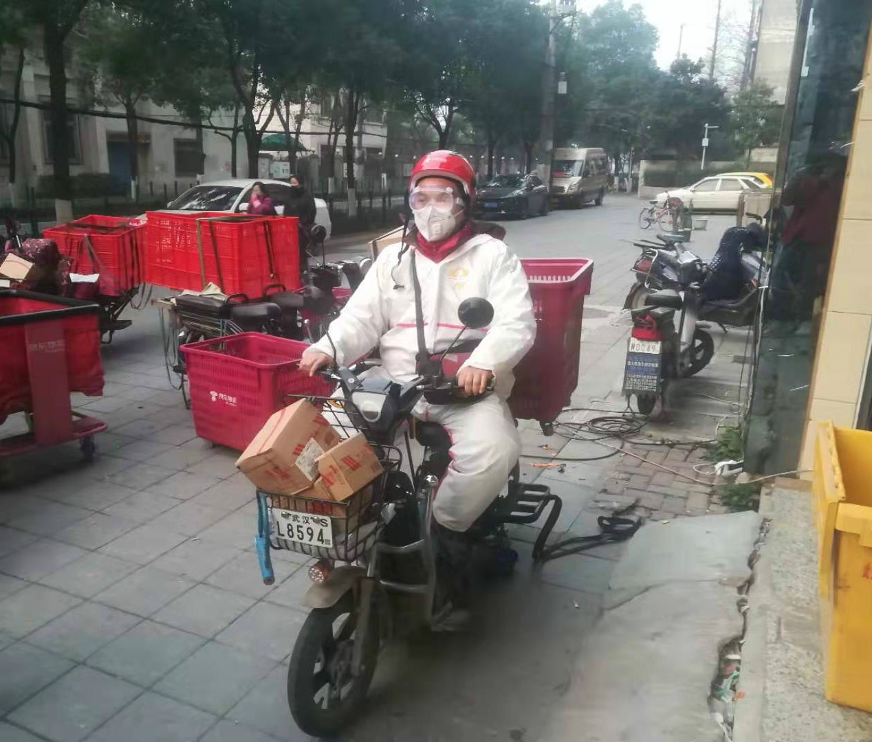 A JD.com courier delivering in Wuhan