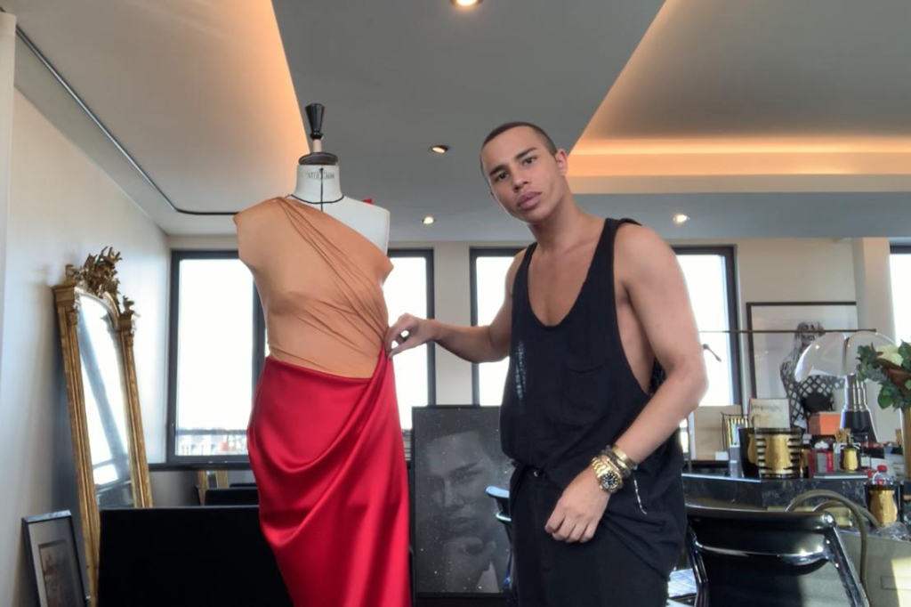 Balmain's Olivier Rousteing draping on a bust form.