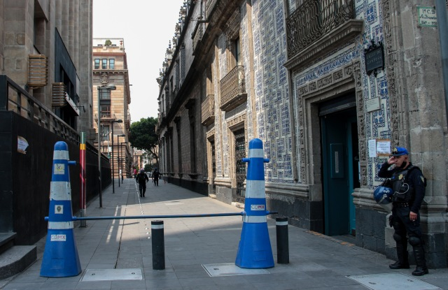 Police officers force close main streets of the downtown to cancel non-essential activities due to the COVID-19 health contingencyCoronavirus outbreak, Mexico City, Mexico - 01 Apr 2020