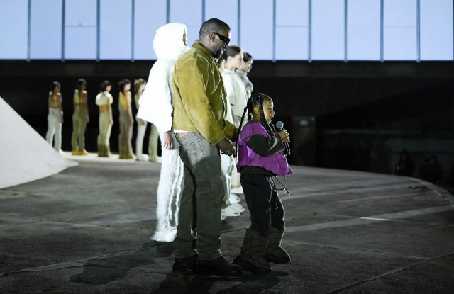 Kanye West and North West on the catwalk.