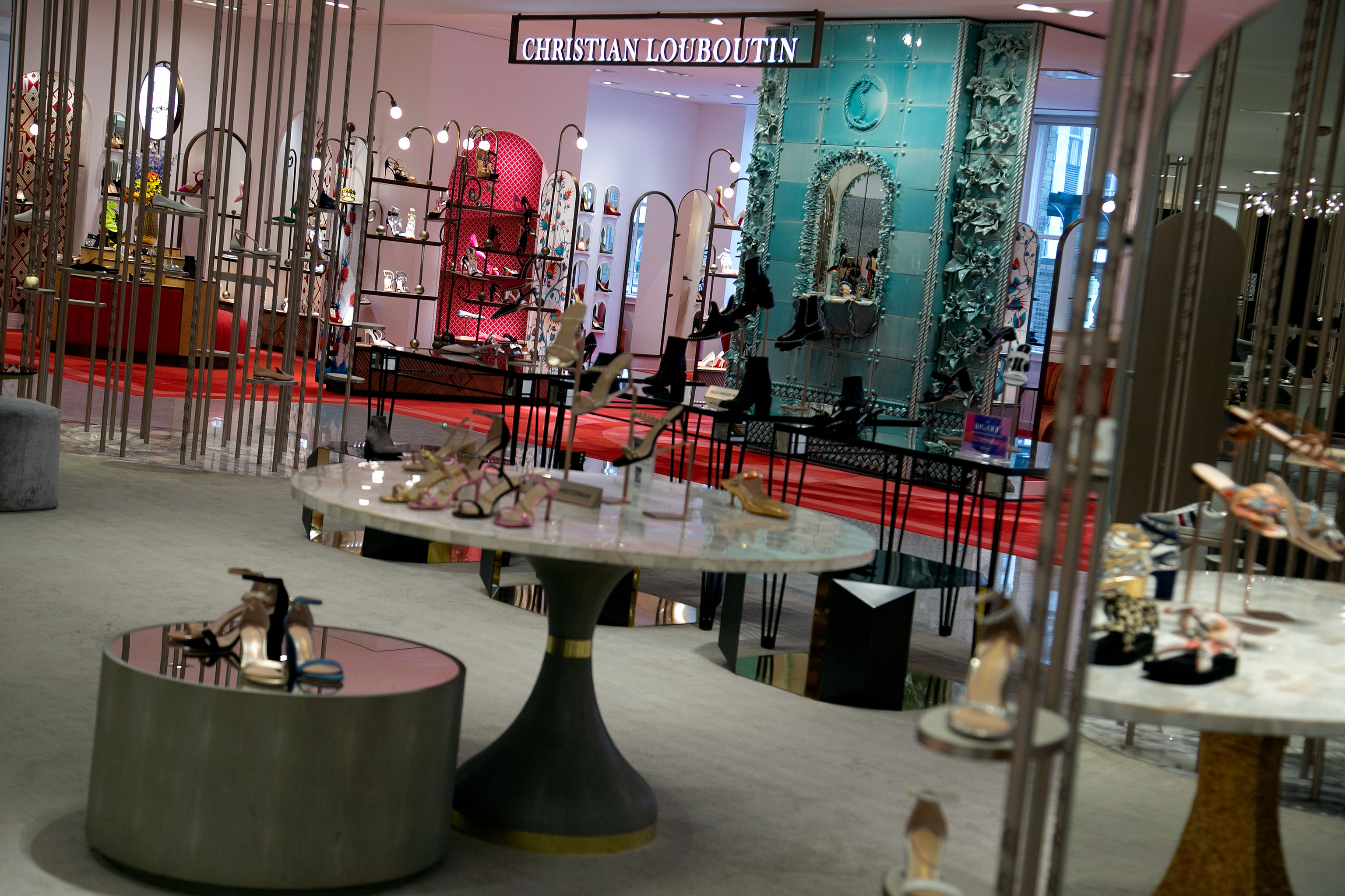 Christian Louboutin's shop-in-shop features a ceramic fountain and aged brass vines.