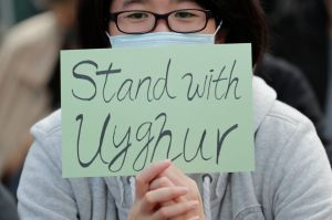 A man holds a sign during a rally to show support for Uighurs and their fight for human rights in Hong KongProtest Uighur, Hong Kong, Hong Kong - 22 Dec 2019