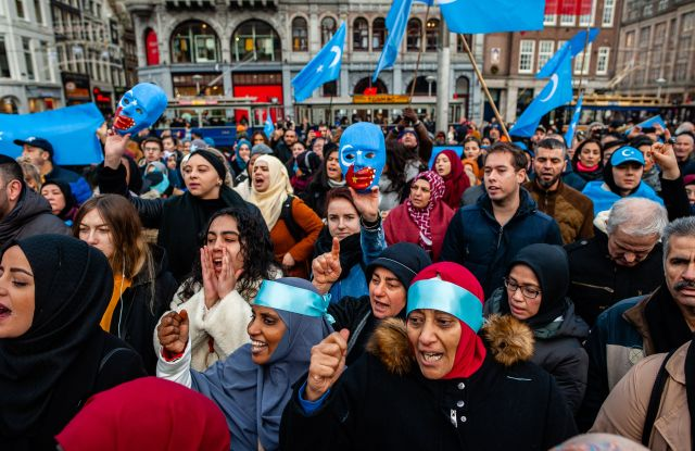 Protesters shout slogans during the demonstration.Hundreds of people gathered at the Dam Square to show their support with China's ethnic Uighurs.Protest in solidarity with the Uyghurs, Amsterdam, Netherlands - 29 Dec 2019The Chinese government has reportedly detained more than a million Muslims at re-education camps. Most of the people who were arbitrarily detained are Uighur, a predominantly Turkic-speaking ethnic group primarily from China's north-western region of Xinjiang. Human rights organisations, UN officials, and many foreign governments are urging China to stop the crackdown.