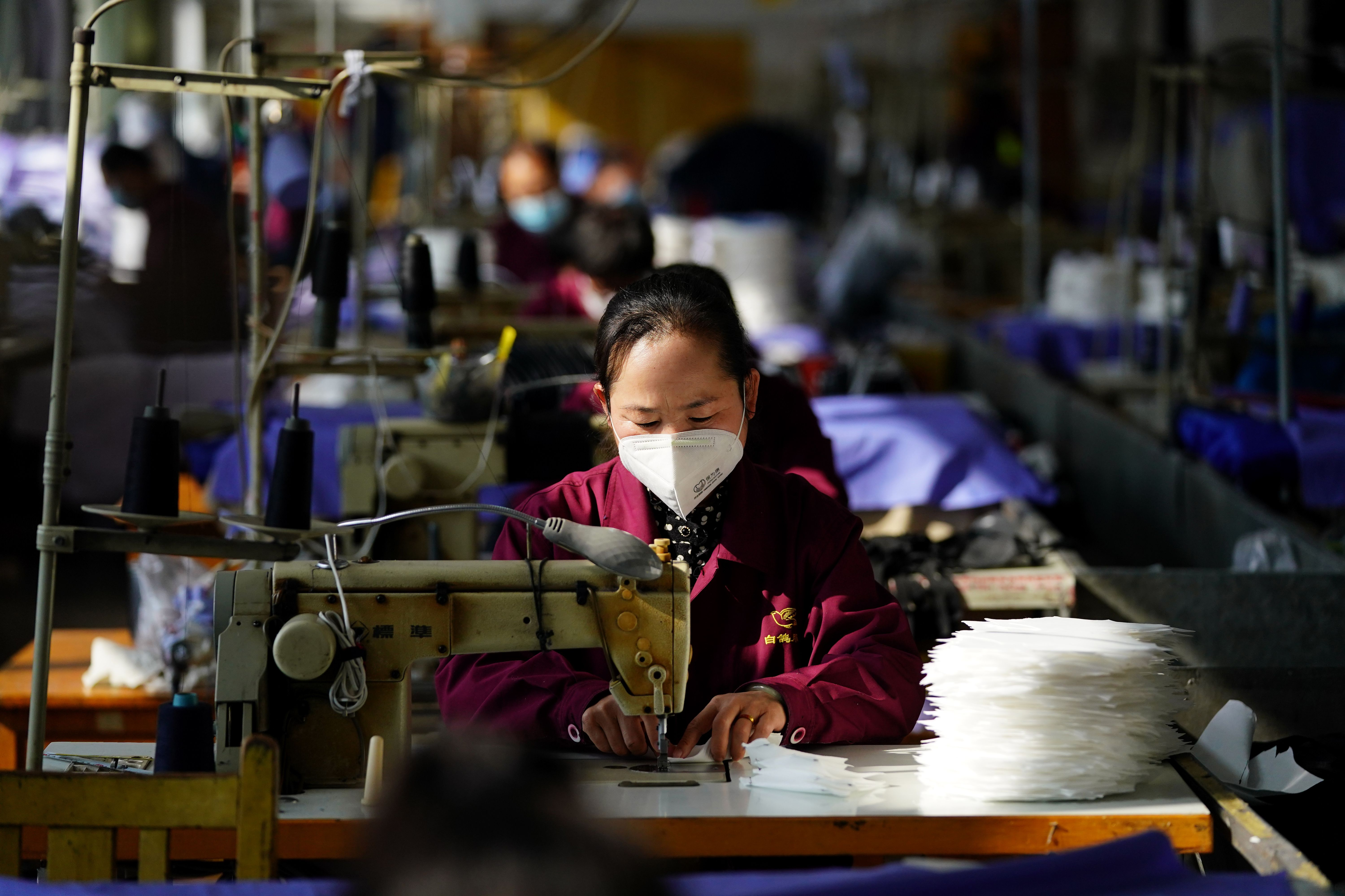 A worker makes face masks at the workshop of a face mask company in Taiyuan.