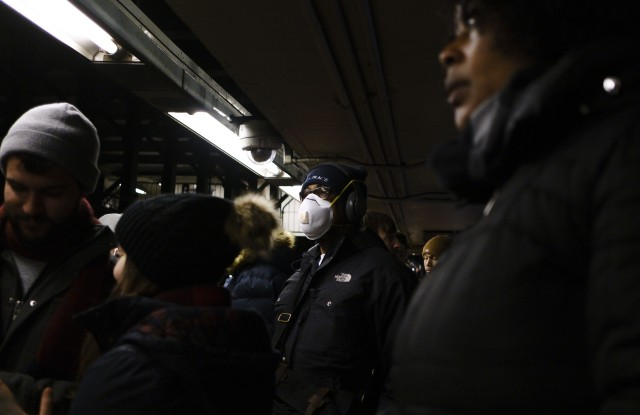 A man wears a mask while waiting for a subway in New York, New York, USA, 28 February 2020. Many people around the world are wearing masks in an effort to protect themselves from the coronavirus, though medical experts are advising that basic paper masks have a limited ability to protect people.People Wearing Masks in New York, USA - 28 Feb 2020