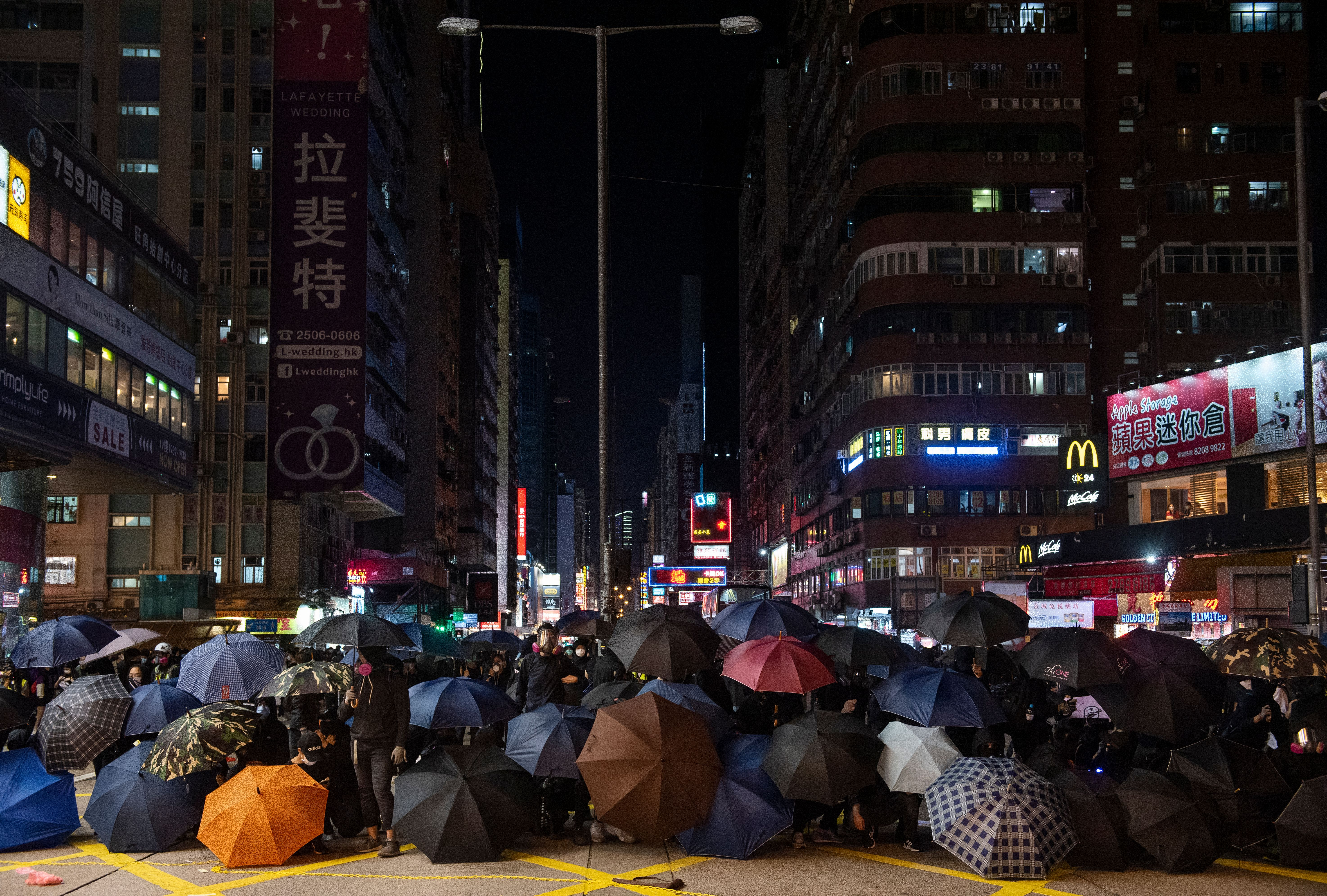 Protesters set up a roadblock with umbrellas during the most recent demonstration.