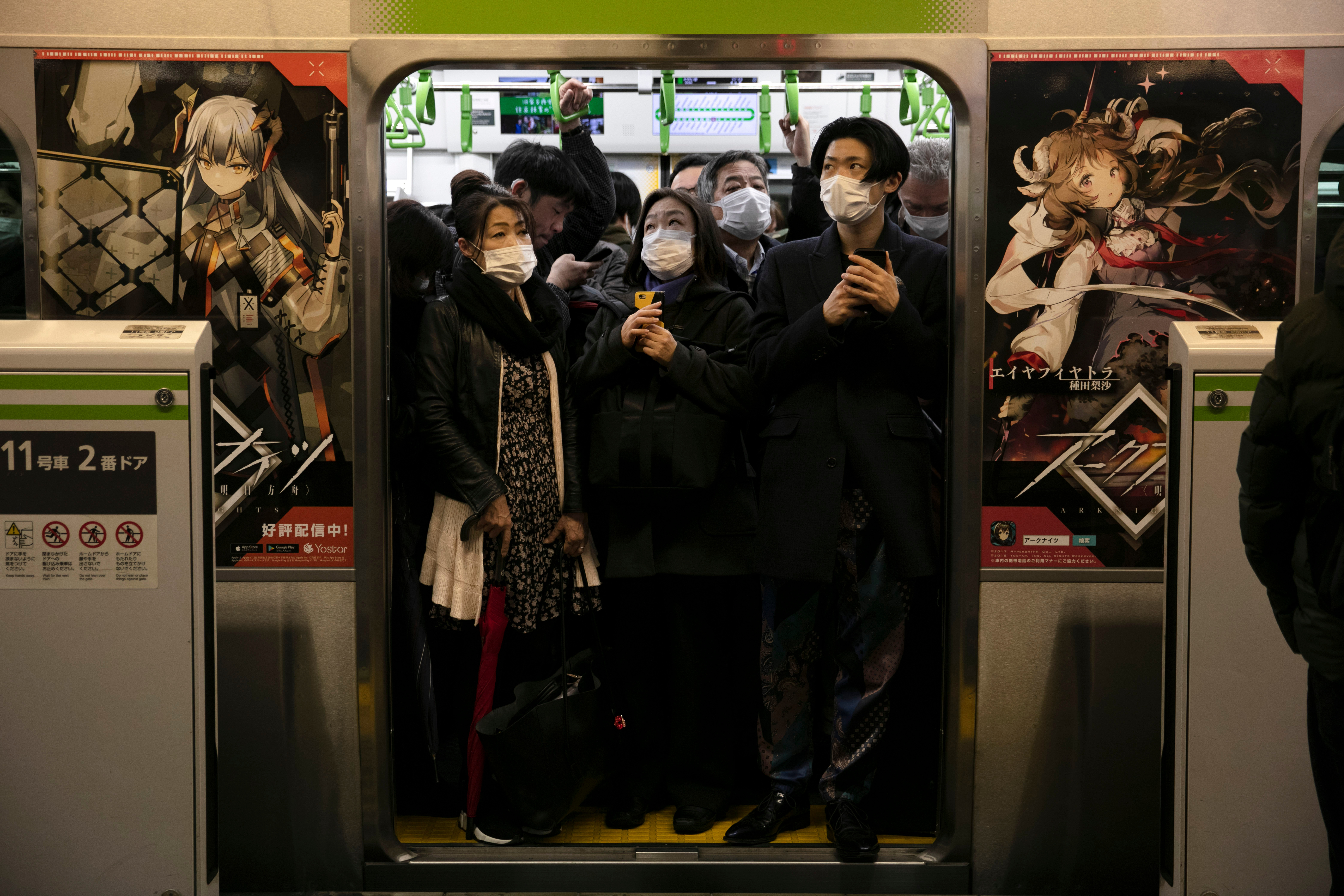 Commuters wearing masks stand in a packed train at the Shinagawa Station in Tokyo, . Coronavirus has spread to more than 60 countries, and more than 3,000 people have died from the COVID-19 illness it causesVirus Outbreak , Tokyo, Japan - 02 Mar 2020
