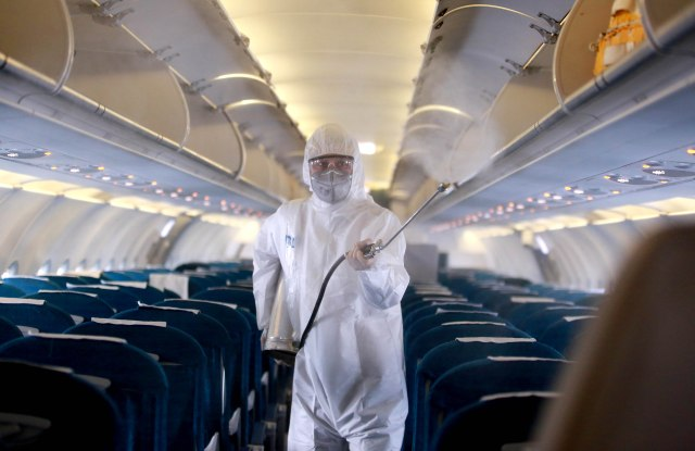 A worker sprays disinfectant as a precaution against the novel coronavirus, inside a Vietnam Airlines airplane at Noi Bai International Airport in Hanoi, Vietnam 03 March 2020. According to latest figures, all 16 people infected with coronavirus in Vietnam have recovered.Preventative measures against coronavirus outbreak, in Vietnam, Hanoi, Viet Nam - 03 Mar 2020
