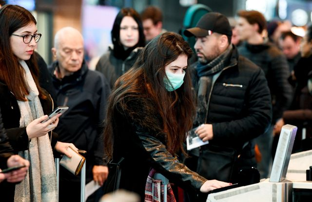 Travellers are protecting themselves against the Ccoronavirus at Charleroi AirportCoronavirus Outbreak, Brussels, Belgium - 03 Mar 2020