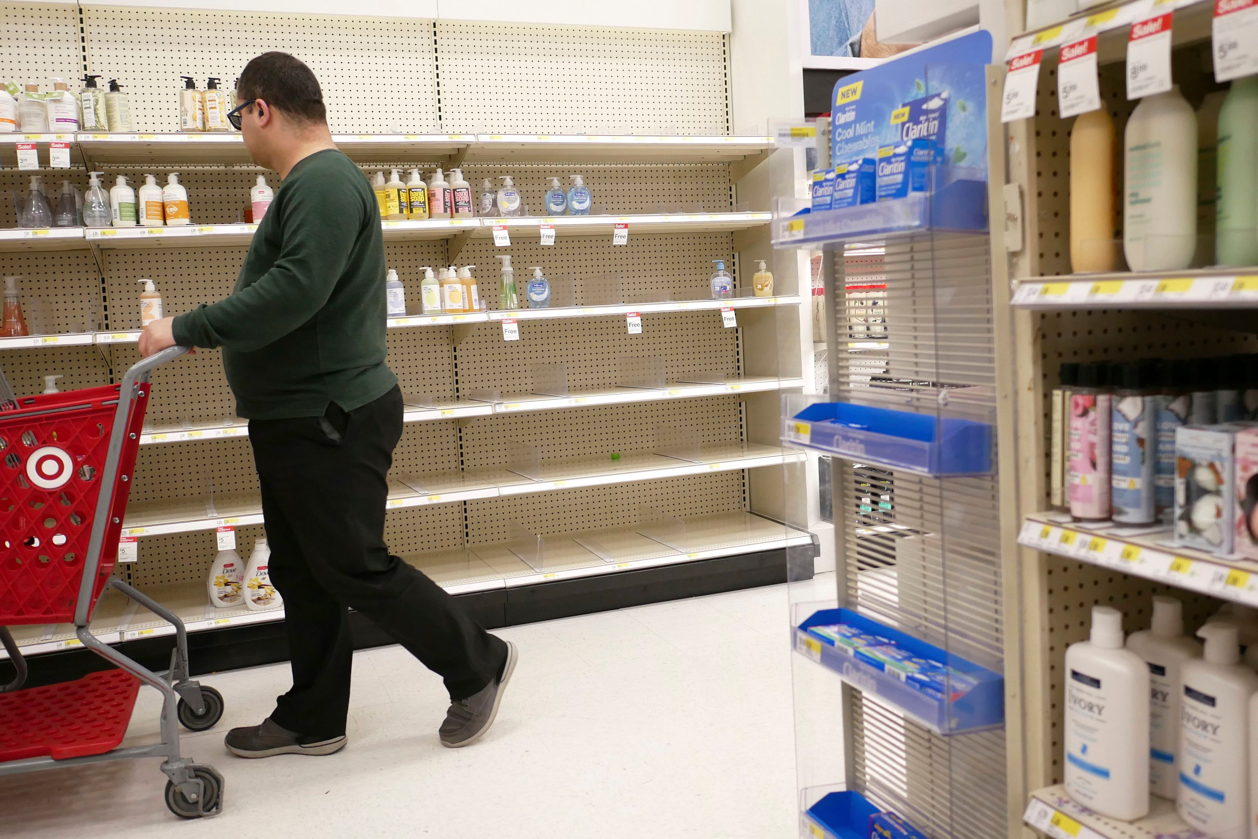 Shelves that held hand sanitizer and hand soap are mostly empty at a Target in Jersey City, N.JVirus Outbreak New Jersey, Jersey City, USA - 03 Mar 2020