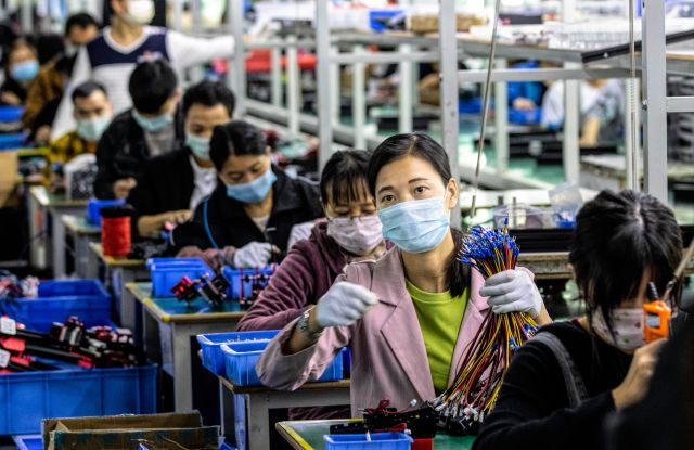 Workers at a factory in Shenzhen, China.