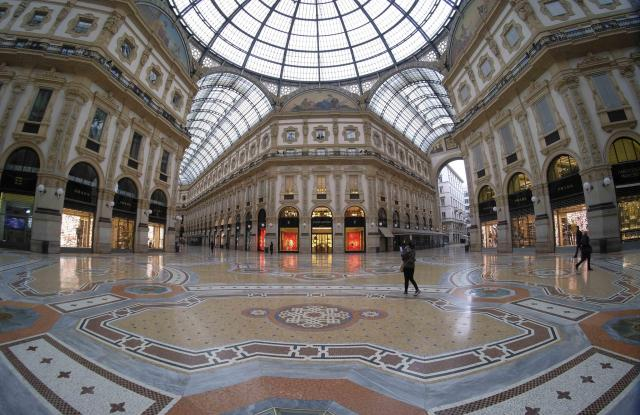 Piazza Del Duomo and Galleria Vittorio Emanuele are deserted, and shops and bars are closed during the Coronavirus emergency lockdown, in Milan, Italy, 12 March 2020.ITALY LOCKDOWN CORONAVIRUS, Milan - 12 Mar 2020