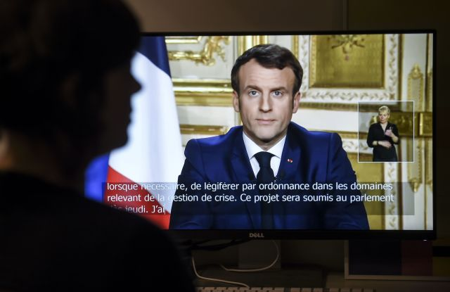 French President Emmanuel Macron is seen on a television screen as he speaks during a televised address to the nation on the outbreak of COVID-19French President Emmanuel Macron's address to the nation, Paris, France - 16 Mar 2020