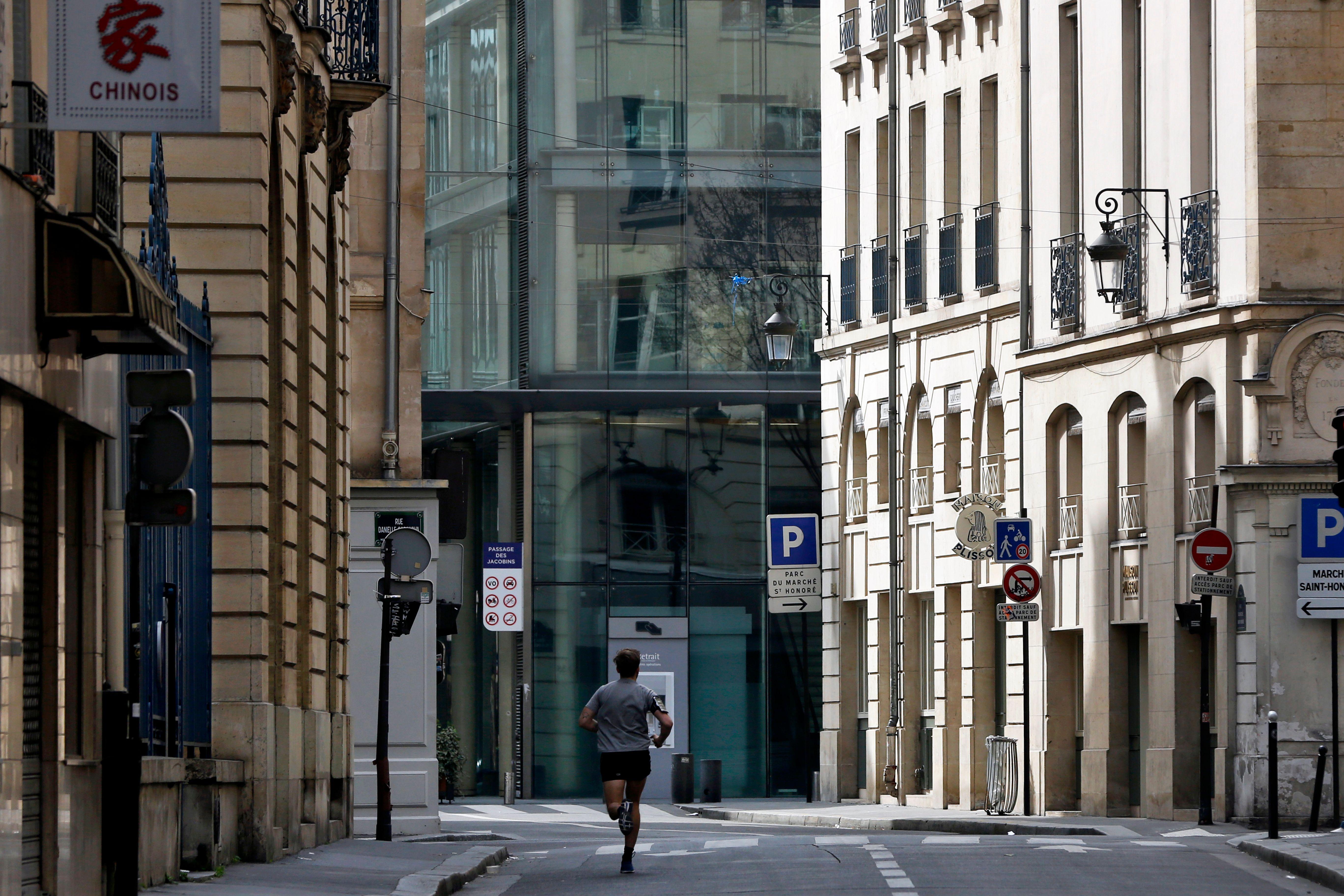 Man runs in an empty street of Paris