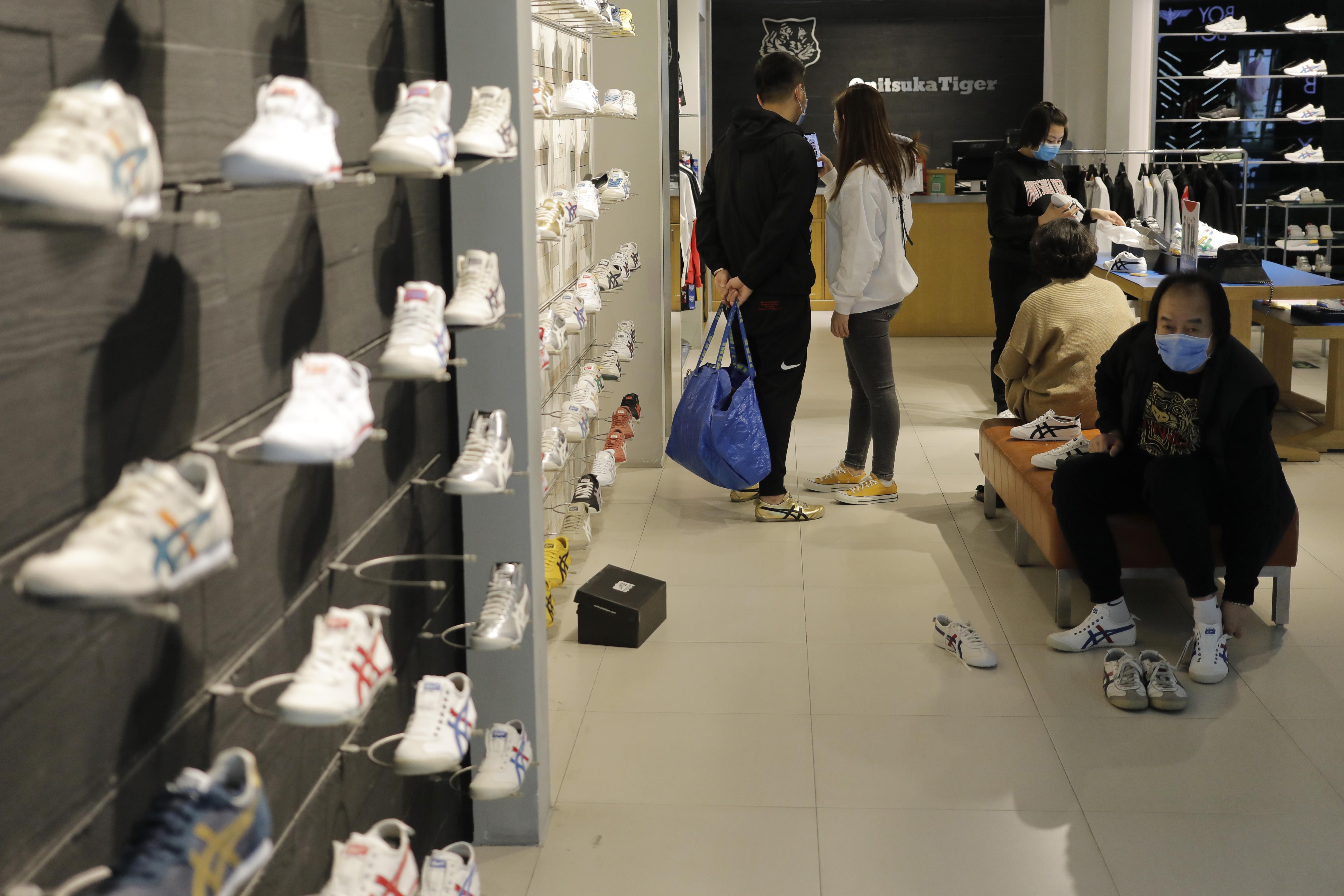 People face masks shoe store Beijing, China