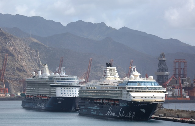 Cruise ships 'Mein Schiff 3' and 'Mein Schiff Herz' are seen docked at the port of Santa Cruz de Tenerife, Canary Islands, Spain, 25 March 2020. Both cruisers have been authorized to dock at the port to repatriate all crew members, some 200 European citizens, on a plane to Frankfurt am Main, Germany. Spain faces the 11th consecutive day of the national lockdown imposed in an effort to slow down the spread of the pandemic COVID-19 disease caused by the SARS-CoV-2 coronavirus.Two cruise ships allowed to dock in Spain's Canary islands, Santa Cruz De Tenerife - 25 Mar 2020