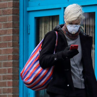 woman in mask with phone coronavirus Seattle
