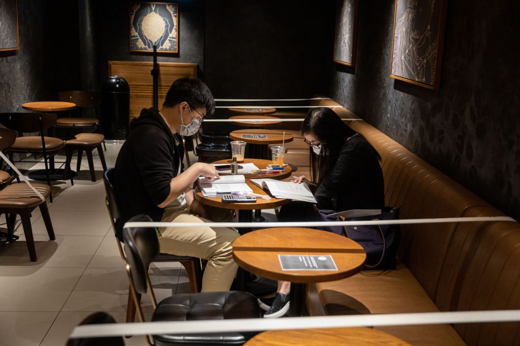 A branch of Starbucks enforces social distancing among its customers by taping off tables and chairs in Hong Kong, China, 29 March 2020. As of noon 29 March public hospitals had reported to the Department of Health the admission of 204 patients in the past 24 hours who met the reporting criteria of SARS-CoV-2 coronavirus, which causes the COVID-19 disease. There are 540 patients under isolation currently.Measures taken against the SARS-CoV-2 coronavirus epidemic in Hong Kong, China - 29 Mar 2020