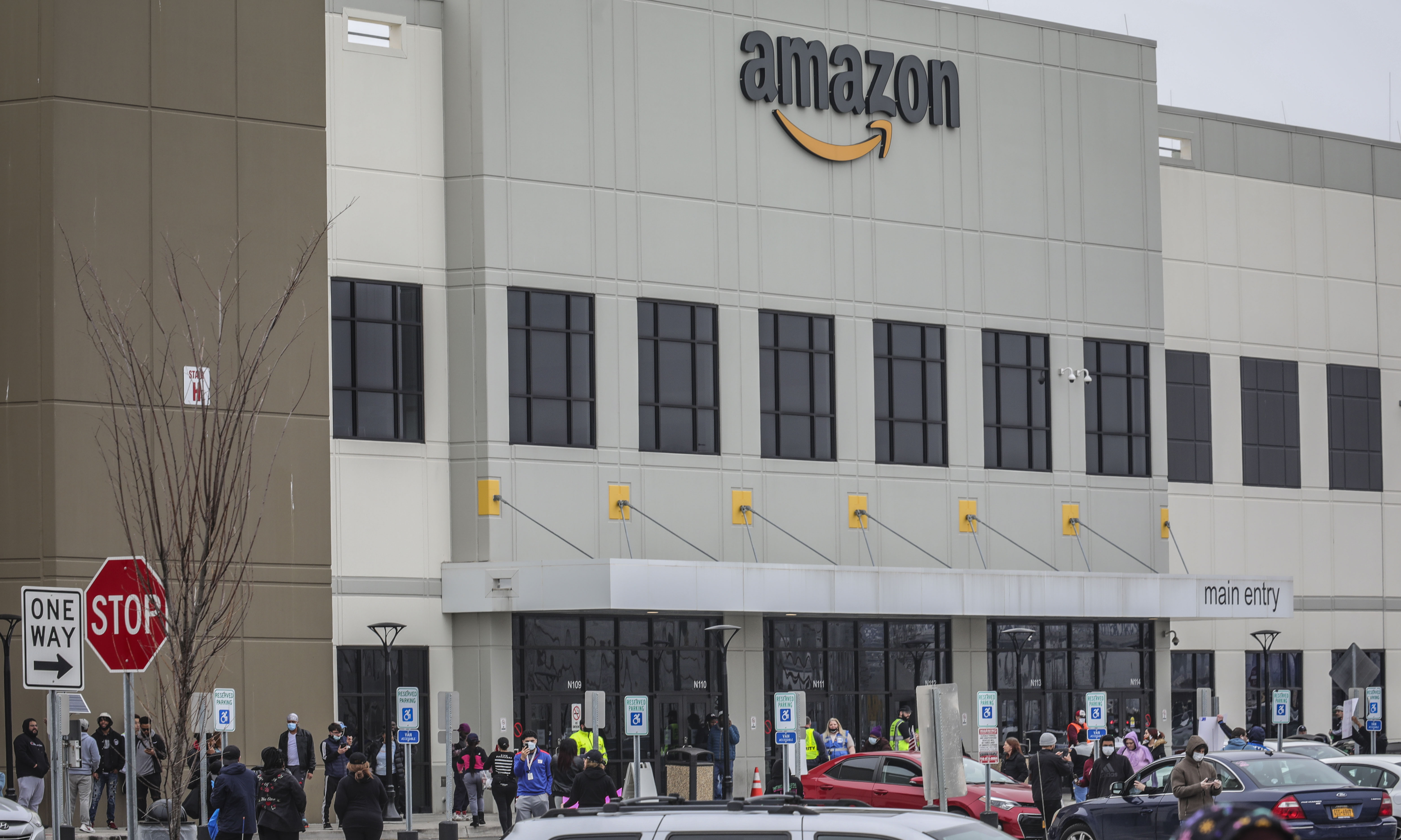 Workers at Amazon's fulfillment center in Staten Island, N.Y., gather outside to protest work conditions in the company's warehouse, in New York. Workers say Amazon is not doing enough to to keep workers safe from the spread of COVID-19 and coronavirusVirus Outbreak-Amazon, New York, United States - 30 Mar 2020