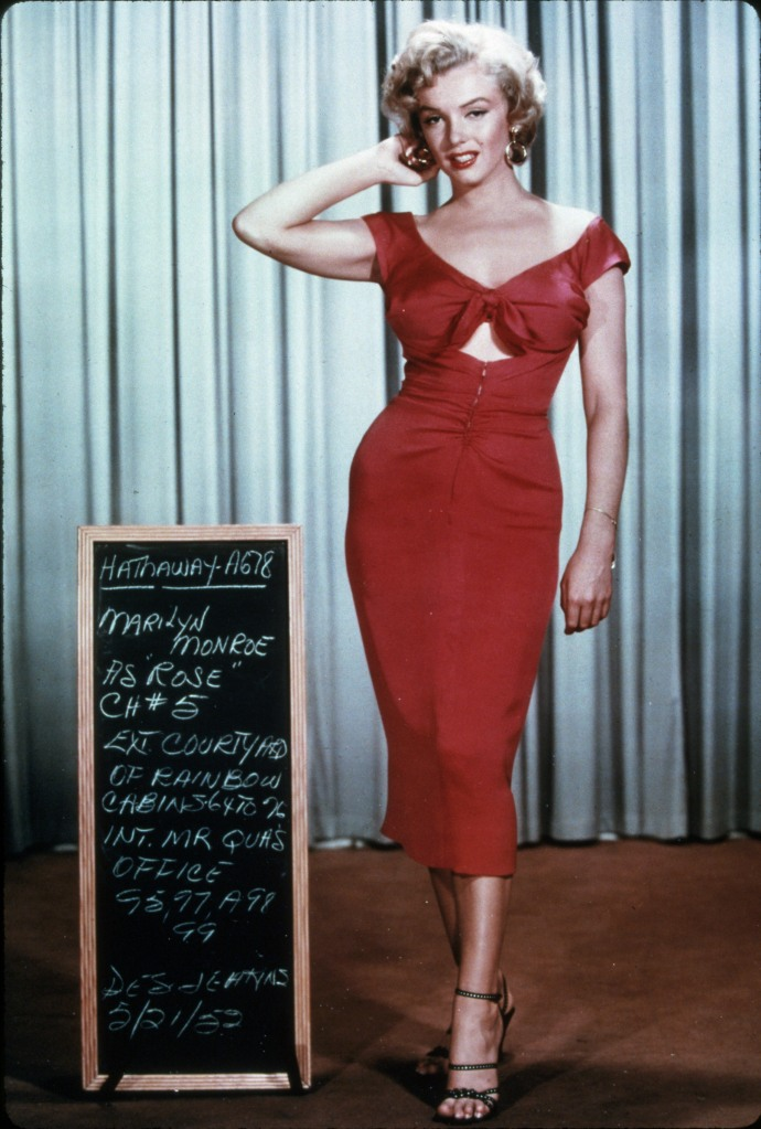 Editorial use onlyMandatory Credit: Photo by Snap/Shutterstock (390877nm)FILM STILLS OF 'NIAGARA' WITH 1953, MARILYN MONROE, DRESS, RED DRESS, FULL LENGTH, HAND BEHIND HEAD, SEXY IN 1953VARIOUS
