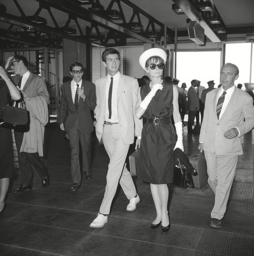 """Audrey Hepburn, Anthony Perkins Hollywood actress Audrey Hepburn, wife of French actor-director Mel Ferrer, and American actor Anthony Perkins walk together, at Rome's Fiumicino """"Leonardo Da Vinci"""" airport, as they met when they descended from a plane that brought them to Rome from Paris. They are both on their way to attend an annual film festival at the famed resort Taormina, on the last coast of SicilyAudrey Hepburn and Anthony Perkins, Rome, Italy"""