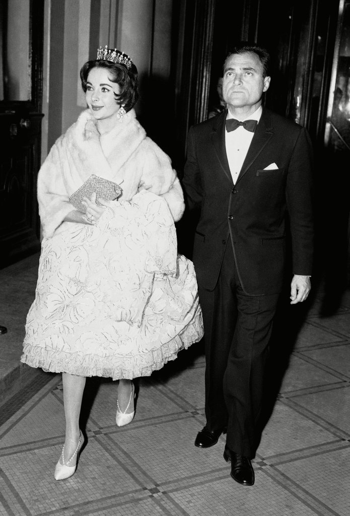 Actress Elizabeth Taylor and her husband producer Mike Todd are seen at the Hotel Continental, Paris, at night on during the annual ball given by the American Community of Paris on the occasion of St. Valentine's DayMike Todd with Elizabeth Taylor, Paris, France
