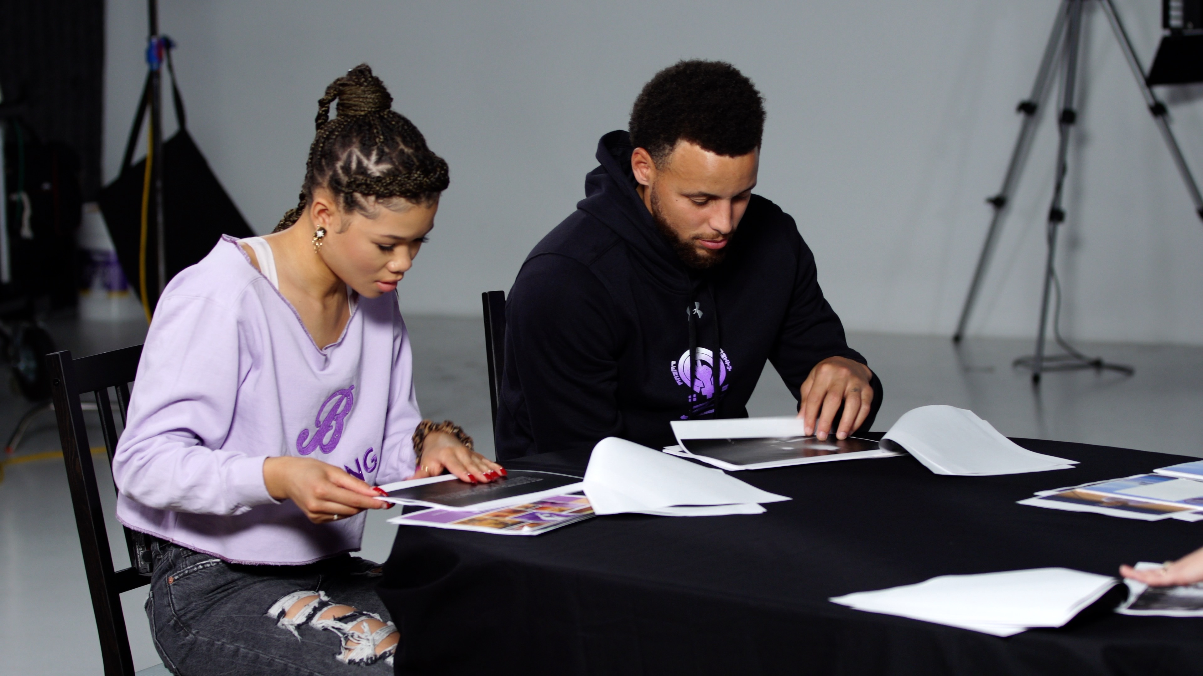 Stephen Curry and Storm Reid work on the Curry 7 Bamazing shoe.